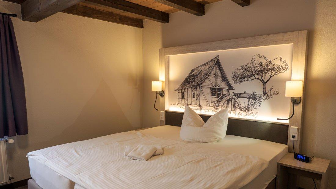 Hotel-zur-Mühle-Wusterhausen-Bettansicht